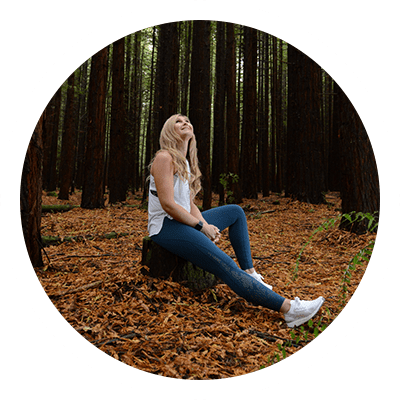 Profile Picture of Rachel Grunwell sitting in the forest