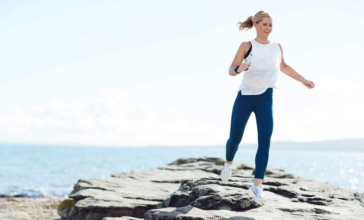 Rachel Grunwell running at the beach